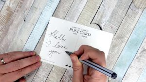 Write your postcards with a uni-ball Air