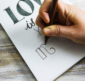 Hand-lettering guide with uni-PIN