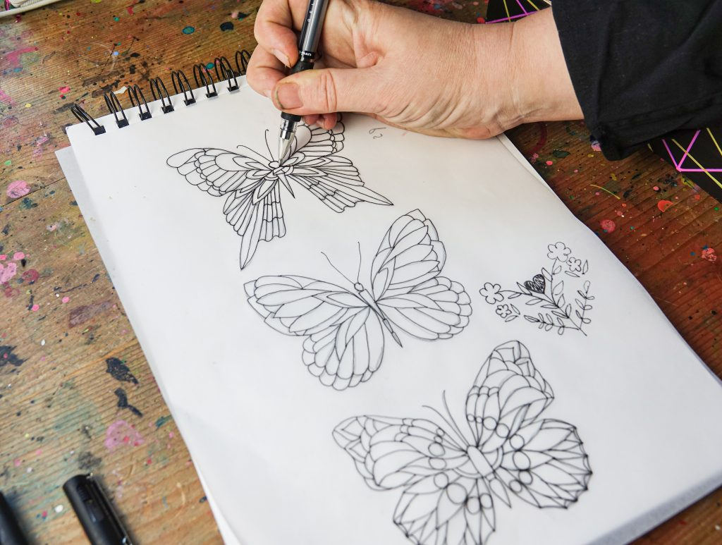 Intricate designs win PIN pens: trace and transfer