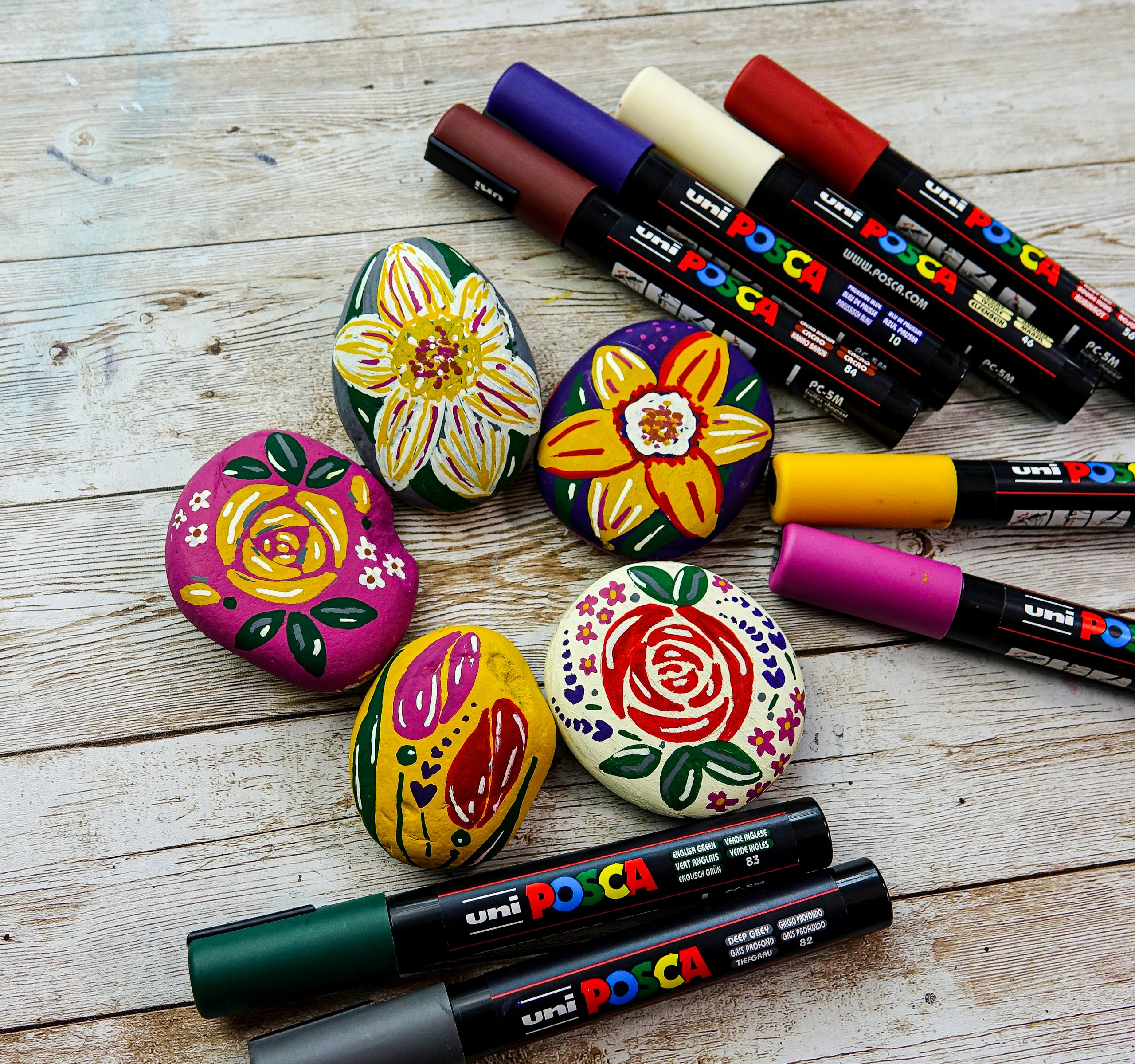 Decorate stones with spring flower designs in POSCA